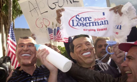 Men wearing Bush and Gore masks respectively rally in front of the Stephen P Clark Goverment Center in Miami on Wednesday 22 November 2000.