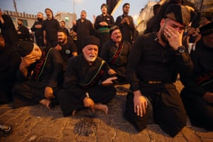 Baghdad, IraqIraqi Shiite Muslim men cry in the capital's mostly Shiite neighbourhood of Kadhimiya on the eve of Ashura. The religious commemoration of Ashura, which includes a ten-day mourning period starting on the first day of Muharram on the Islamic calendar, commemorates the seventh-century slaying of Prophet Mohammed's grandson Imam Hussein in Karbala