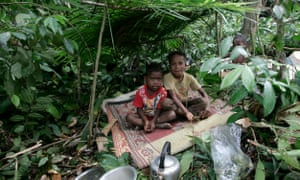 Children from the Batek tribe play in the jungle near their village.
