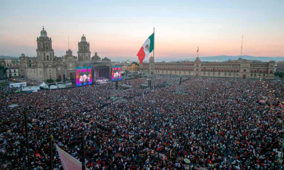 Amlo supporters watch his inauguration ceremony on a big screen at the Zócalo square in Mexico City.