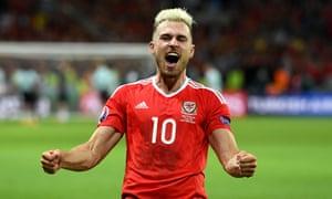 Aaron Ramsey celebrates after Wales' win over Belgium.