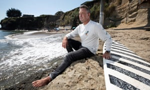 Shawn Dollar on Privates Beach in Santa Cruz, California, which costs $100 a year to access.