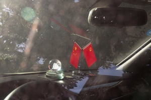 Flags on the dashboard of a car
