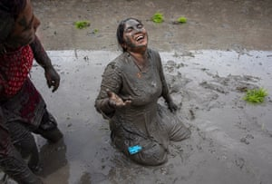 A person in a paddy field on National Paddy Day