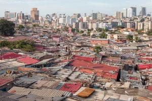 The line which divides the shacks of a poor neighbourhoods from the rich area of Luanda