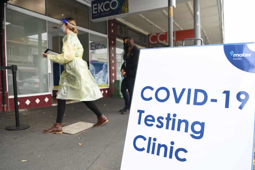A health worker walks outside a Covid-19 testing clinic in Brisbane on Tuesday.