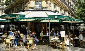 People eat out in Paris as outdoor dining reopens. Fully vaccinated people from the UK will be able to visit the EU this summer.