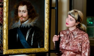 Pippa Stephenson stands next to a painting of George Villiers