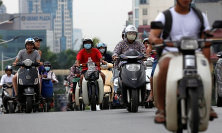 Scooters are seen on a street in Hanoi, Vietnam