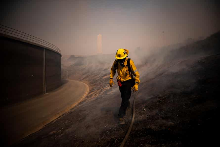 Firefighters work to control the Silverado fire near Irvine, California, on 26 October.