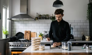 Brad Vanstone makes vegan cheese in his kitchen.