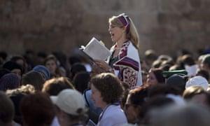 A Jewish woman prays at the Western Wall