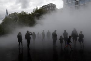 London, UKPeople interact with the installation 'London Fog (2017)' by Japanese artist Fujiko Nakaya at the Tate Modern