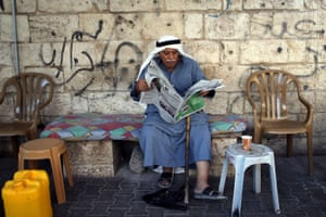 A man catches up on news about Israel's tightly contested parliamentary election in Gaza