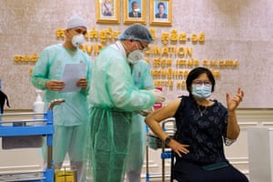 A woman receives a vaccine as Cambodia starts its coronavirus vaccine rollout with 600,000 doses of Sinopharm vaccine donated by China in Phnom Penh, Cambodia, on 10 February, 2021.