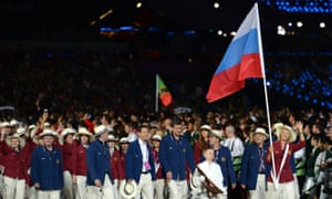 Maria Sharapova carries her country's flag during the London 2012 opening ceremony.