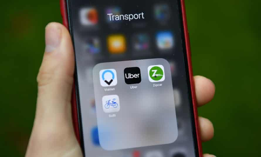 Transport apps including Uber and Zipcar are seen on a smartphone