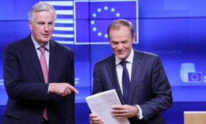 Michel Barnier (left) presents a draft Brexit withdrawal agreement to Donald Tusk in Brussels.