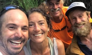 Amanda Eller, seen with some of those who found her. According to her father, Eller arrived at hospital 'pretty banged up, but mentally in perfect shape'.