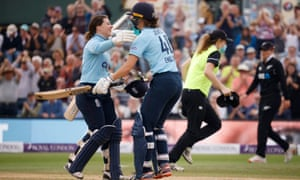 England's Tammy Beaumont celebrates reaching her century with Amy Jones.