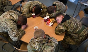 Soldiers from 2 LANCS resting for a few minutes awaiting the next task after the army was brought in to assist.