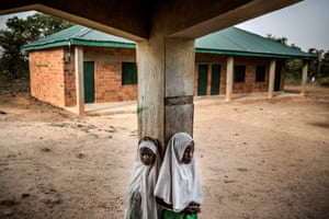 Two Fulani girls gather outside a classroom prior to the beginning of the day's lessons at Wuro Fulbe nomadic school in the Kacha Grazing Reserve for Fulani people.