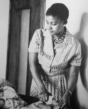 Winnie Mandela ironing at home in Soweto