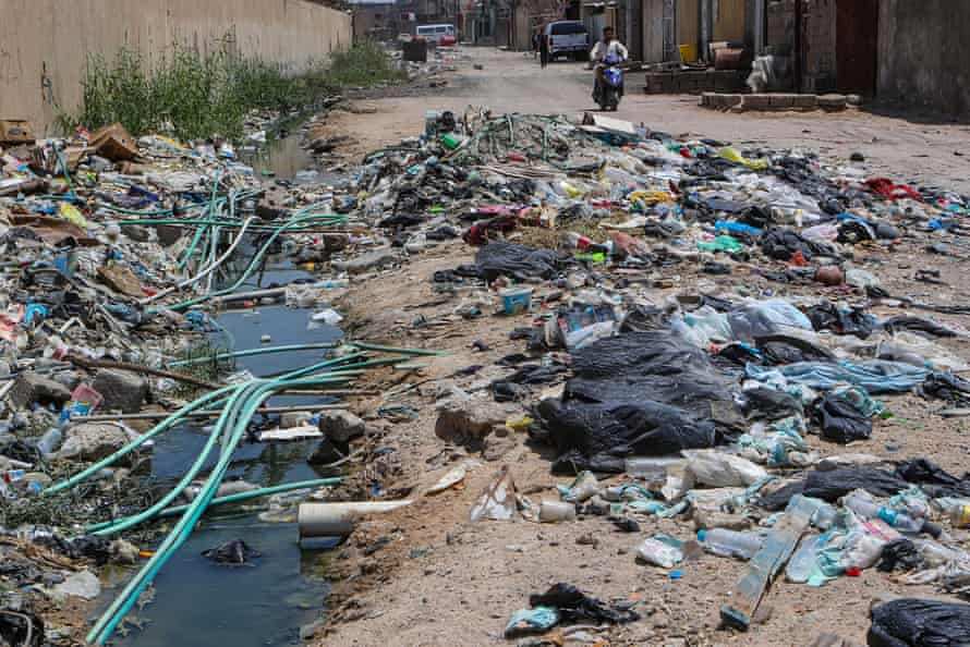 20 July 2019. Portable water pipes mix with sewage at a garbage dump in Basra, southeast of Baghdad, Iraq.