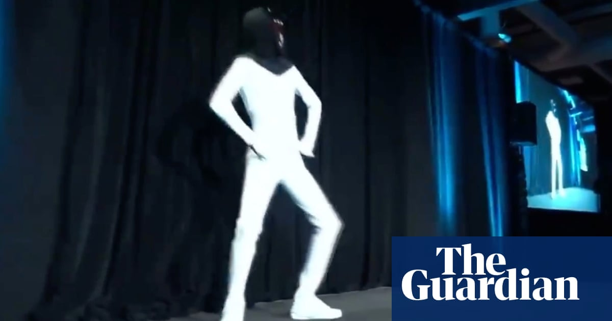 Elon Musk unveils plan for 'Tesla Bot' with man dancing in a bodysuit – video