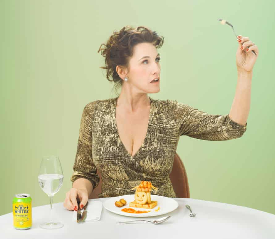 Grace Dent with a plate of potato smiles in front of her