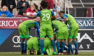 Jordan Morris is swamped by team-mates after sending the Sounders through to the MLS Cup