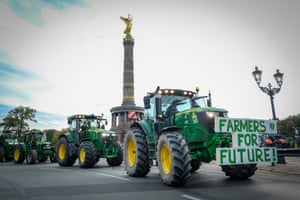 Berlin, GermanyFarmers ride their tractors into the city centre past the Victory Column to protest against new agriculture legislation.