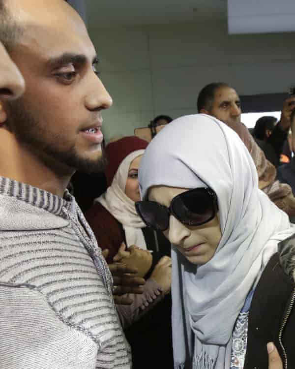 Shaima Swileh, right, stands with her husband Ali Hassan after she arrived at San Francisco international airport on 19 December.