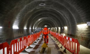 A construction worker in a tunnel at the site for a new Crossrail station in London.