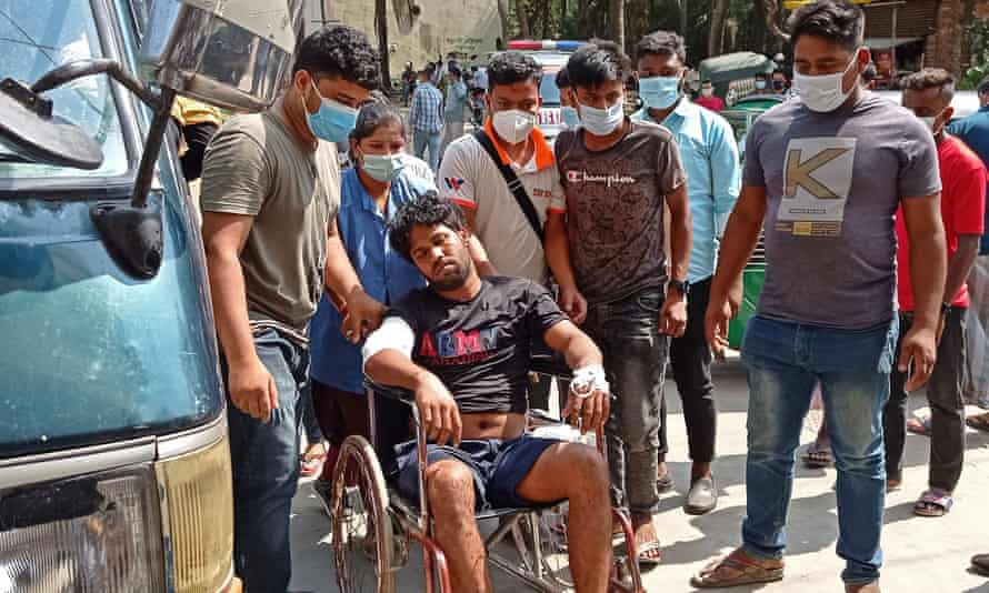 An injured man rests on a wheelchair after being treated at a hospital in Chittagong after the protest.
