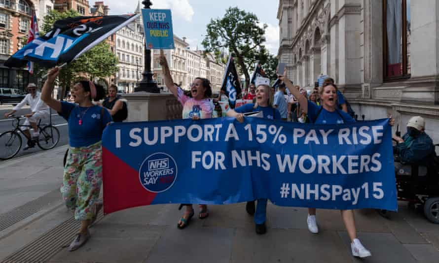 NHS staff, trade union members and health campaigners protest about pay