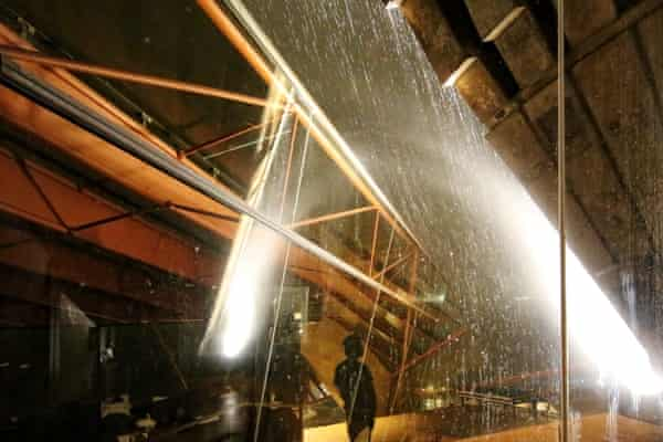 'It patters, pounds and thrums': a storm hits the glass windows of the northern foyer at the Sydney Opera House