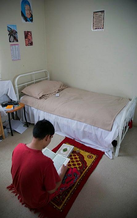 Ali, a 19-year-old Hazara asylum seeker, prays in his home in western Sydney