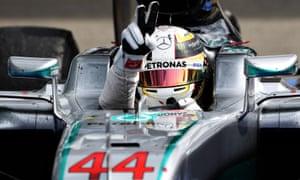 Lewis Hamilton celebrates his win in parc ferme.
