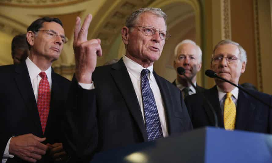 Senate Environment and Public Works Chairman James Inhofe (R-OK) talks with reporters with (L-R) Sen. John Barrasso (R-WY), Sen. John Cornyn (R-TX) and Majority Leader Mitch McConnell (R-KY) at the U.S. Capitol. Inhofe believes global warming is a hoax, and his fellow Republican senators deny that we need to mitigate the problem.