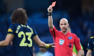 David Luiz is shown a red card by Anthony Taylor.