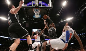 Brooklyn Nets point guard Kyrie Irving grabs a rebound against the New York Knicks.