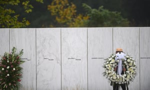 A US park ranger moves a memorial wreath on 11 September 2020 in Shanksville, Pennsylvania.