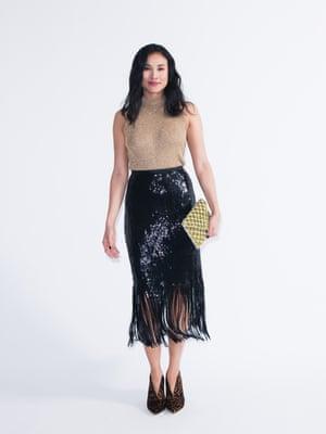 Model wears racer vest, £20, and pencil skirt, £46, both riverisland.com. Boots, £150, boden.co.uk. Clutch, £110, anthropologie.com.