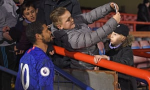 Ruben Loftus-Cheek poses with fans after Chelsea's match against Everton in the Premier League 2.