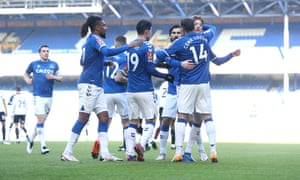 Cenk Tosun of Everton celebrates with team mates.