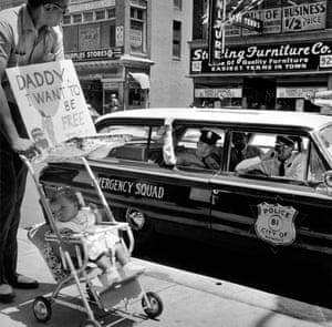 William Edwin Jones pushes daughter Renee Andrewnetta Jones (8 months old) during protest, Main Street, Memphis, Tennessee, 1950's