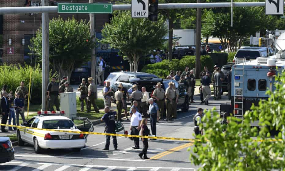 Police secure the scene of the shooting at an office building housing the Capital Gazette newspaper in Annapolis, Maryland.