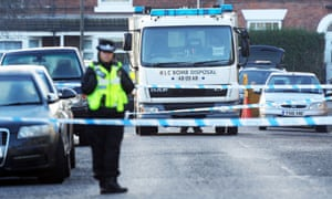 Police and the bomb disposal unit outside a property in Chesterfield, Derbyshire.