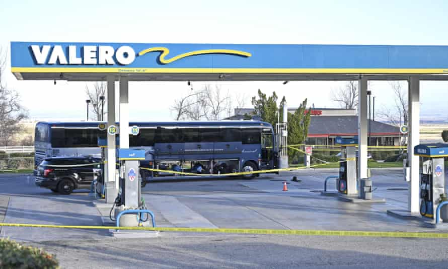 Investigators are seen outside of a Greyhound bus after a passenger was killed onboard on Monday in Lebec, California.